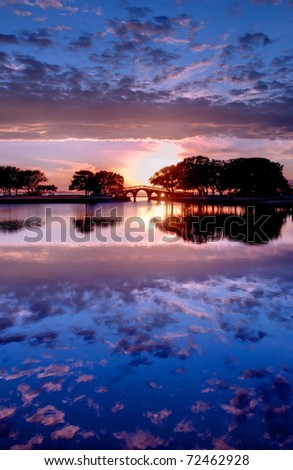 Sunset in the Outer Banks, North Carolina overlooking the Tranquility Bridge at the Whalehead Club at the Currituck Heritage Park. - stock photo