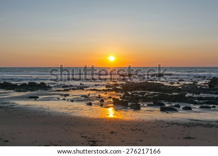 Sunset in the Pacific - stock photo