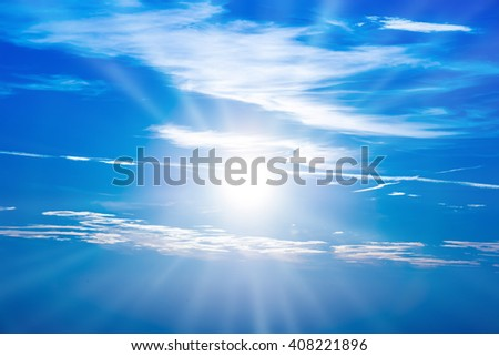 Sunset in the sky with blue clouds and big sun - stock photo