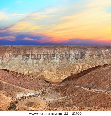 Sunset in the stone desert.Stone desert landscape.Geological erosion land form in stone desert of Negev, National Park. Israel - stock photo