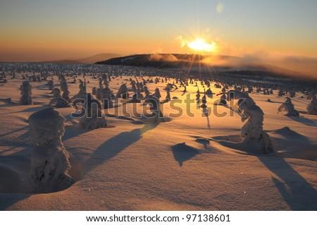 Sunset in the winter mountains landscape, The Krkonose mountain, Czech republic - stock photo