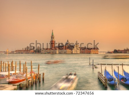 Sunset in Venice on the San Giorgio Island.In the distance can be seen The Church of San Giorgio Maggiore, designed by Andreea Palladio and a Benedictine monastery.
