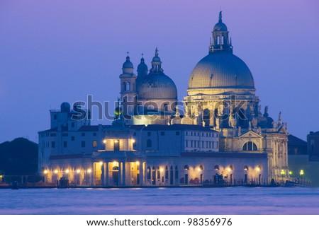 Sunset in Venice with night view on Basilica della Salute - stock photo