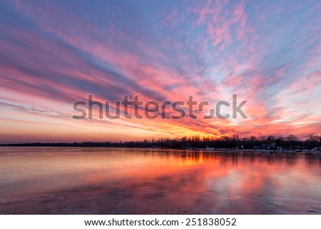 Sunset in winter from a froze lake Balaton - stock photo