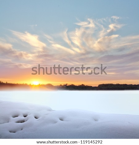 Sunset in winter. Winter landscape. - stock photo