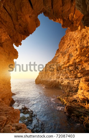 Sunset into grotto. Nature composition.