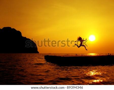 Sunset Jump - stock photo