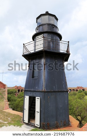 Sunset Key Lighthouse sits atop the battlements of Fort Jefferson in Dry Tortugas National Park, Florida. - stock photo