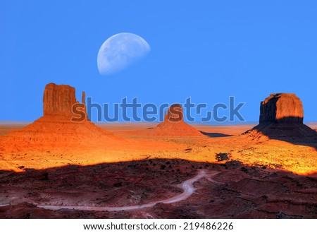 Sunset Large moon over Monument Valley Arizona - stock photo
