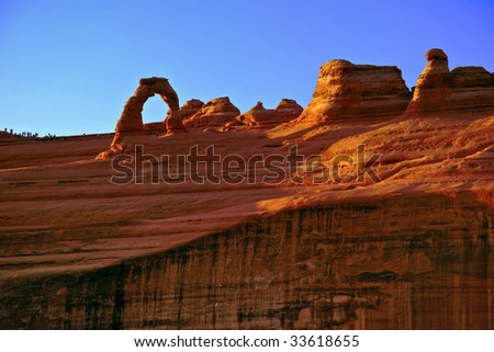 Sunset light around  Delicate Arch in the Arches canyon. Utah. USA - stock photo