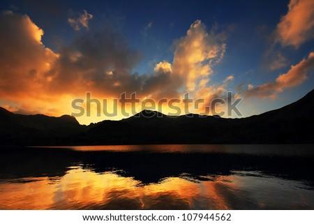Sunset light in National Park Retezat, Romania - stock photo