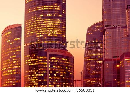 Sunset light on modern skyscrapers at evening - stock photo