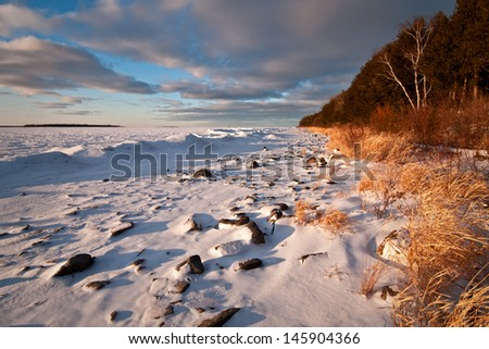Sunset light on the winter shoreline of Peninsula State Park in Door County, Wisconsin.