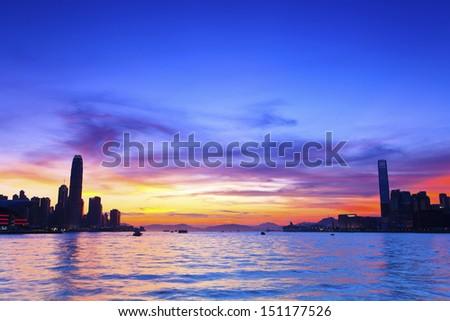 Sunset modern city - stock photo