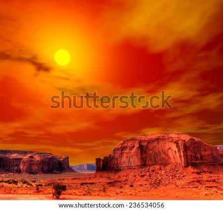 Sunset Monument Valley Arizona with evening warm skies - stock photo