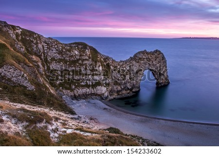 Sunset of  Durdle Door, on the Jurassic Coast of Dorset in United Kindom. - stock photo
