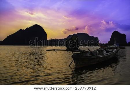 Sunset of fishing boat - stock photo