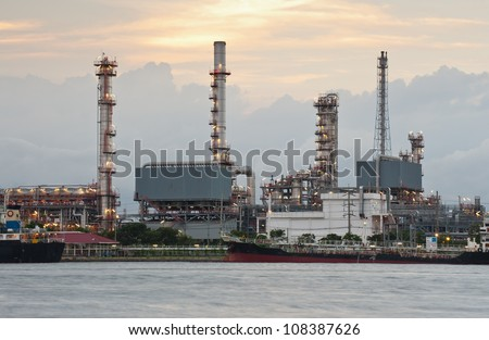 Sunset of Oil refinery plant along river in Bangkok