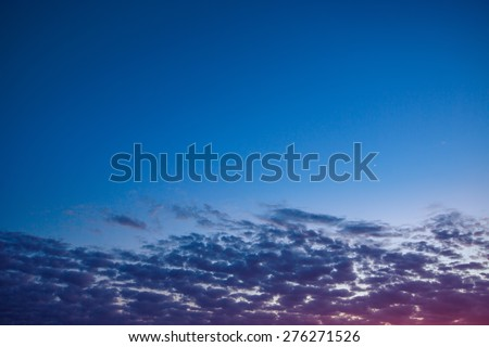 Sunset of small clouds in the blue sky - stock photo