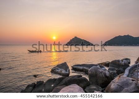Sunset of White Black Rock Beach in the Island Ocean Orange Pink Sunset Sea Sky. Koh Tao and Koh Nang Yuan Thailand - stock photo