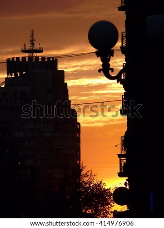 Sunset on a background of houses in the center of Kiev