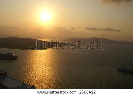 Sunset on a greek island santorini - tourist paradise - stock photo