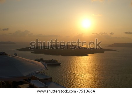Sunset on a greek island santorini - tourist paradise - stock photo