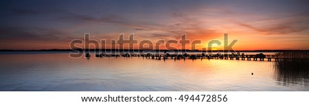 Sunset on a Lake with Marina in Winter