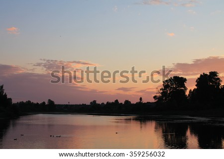 Sunset on a pond with ducks
