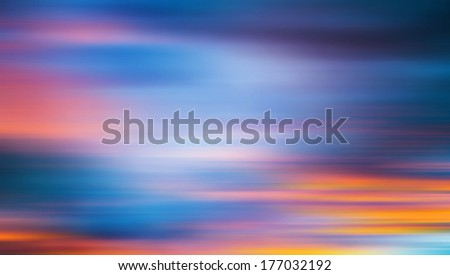 Sunset on a wild beach in Guanacaste, Costa Rica. Dramatic red and blue sunset sky. Clouds motion blur. Abstract romantic travel vacation concept  - stock photo