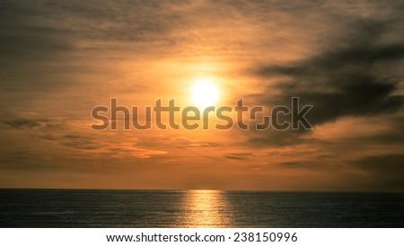 Sunset on Beach with Pacific Ocean Horizon - Waves on West Coast in Santa Monica California - stock photo