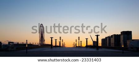 sunset on bridge with ferris - stock photo