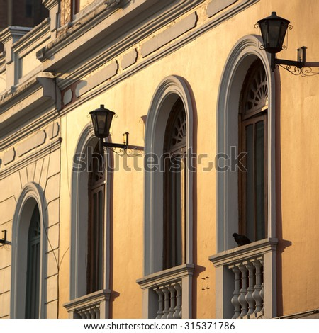 Sunset on colonial architecture in the historic neighborhood of La Candelaria in Bogota. Colombia - stock photo