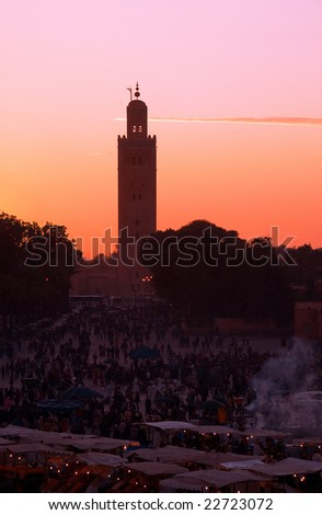 Sunset on Djemaa El-fna square and Koutoubia mosque. Marrakech. Morocco