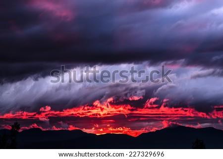 Sunset on fire - stock photo