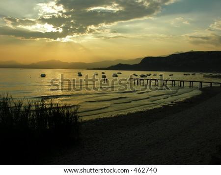 sunset on Garda Lake - stock photo