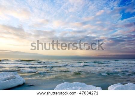 sunset on icy sea - stock photo