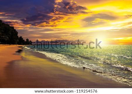 Sunset on Khao Lak beach in Thailand. - stock photo