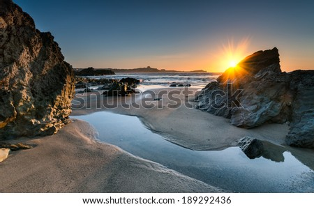 Sunset on Lusty Glaze beach at Newquay in Cornwall - stock photo