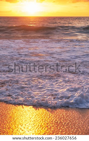 Sunset on Mai Khao beach in Phuket, Thailand - stock photo