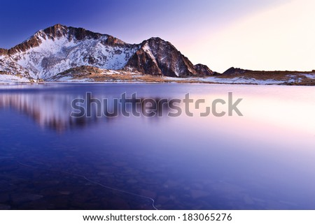 sunset on mountain lake - stock photo