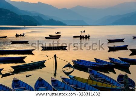 Sunset on Phewa Lake in Pokhara, Nepal - stock photo