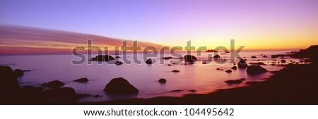 Sunset on rocky Pacific shoreline, Northern California - stock photo