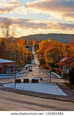 Sunset on street in autumn in Finland - stock photo