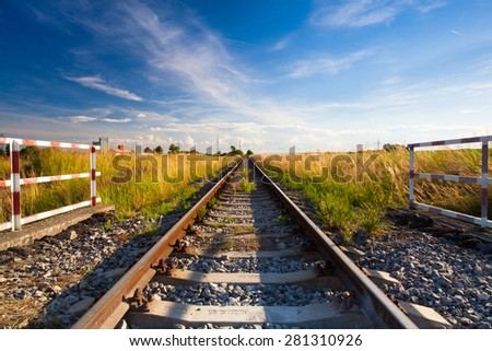 Sunset on the abandoned railway track - stock photo