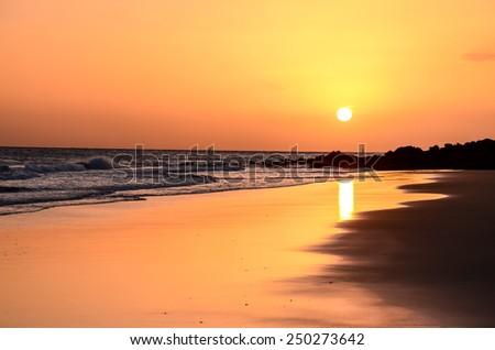 Sunset on the Atlantic Ocean El Medano Tenerife Canary Islands Spain - stock photo