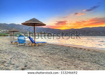 Sunset on the beach of Mirabello Bay, Greece - stock photo