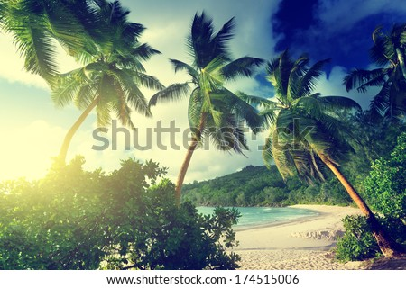 sunset on the beach Takamaka, Mahe island, Seychelles - stock photo