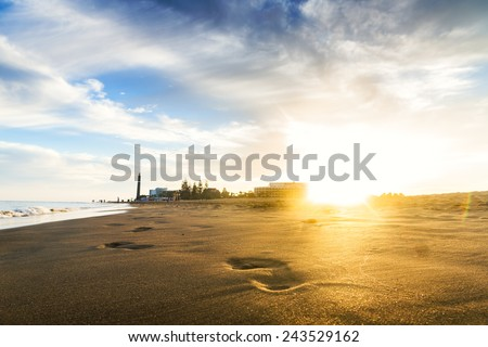 Sunset on the beach. The footprints. Canary islands, Maspalomas. - stock photo