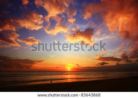 Sunset on the beach with the beautiful cloud - stock photo